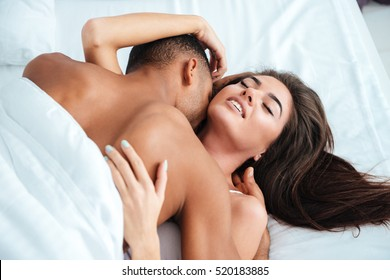 making couple out bed in